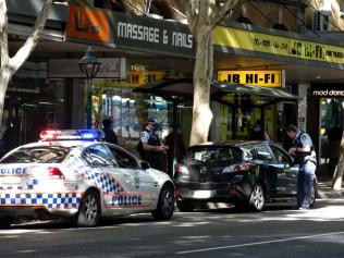 The boys in blue ticketing a motorist.
