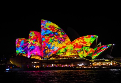 The iconic Opera House bathed in a laser show.